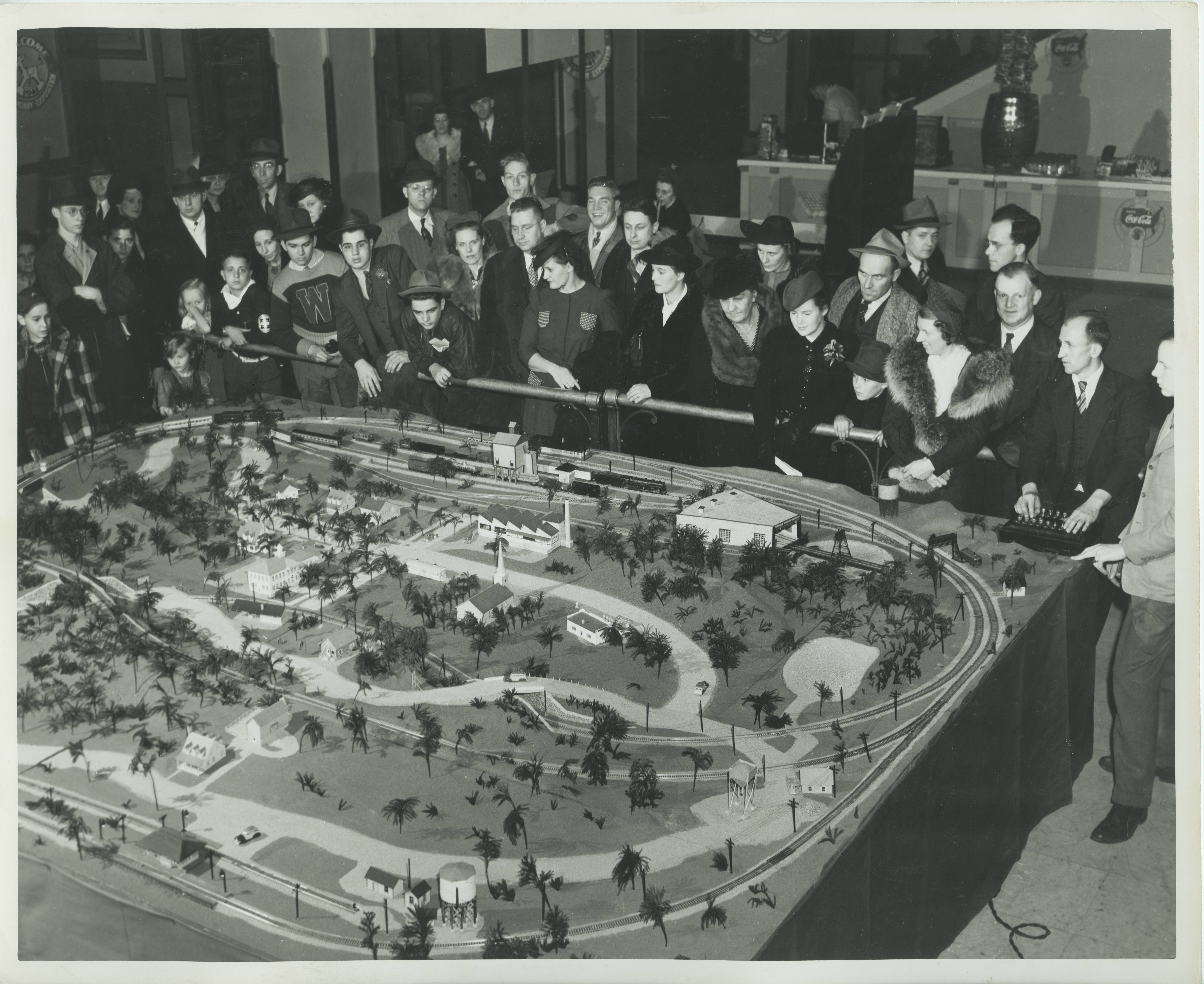 <table class=&quot;lightbox&quot;><tr><td colspan=2 class=&quot;lightbox-title&quot;>Large Model Railroad Display</td></tr><tr><td colspan=2 class=&quot;lightbox-caption&quot;>A crowd gathers around a large scale model railroad at the Wisconsin Hobby Exposition in Milwaukee in 1949.</td></tr><tr><td colspan=2 class=&quot;lightbox-spacer&quot;></td></tr><tr class=&quot;lightbox-detail&quot;><td class=&quot;cell-title&quot;>Source: </td><td class=&quot;cell-value&quot;>From the Historic Photo Collection of the Milwaukee Public Library. Reprinted with permission. <br /><a href=&quot;http://content.mpl.org/cdm/singleitem/collection/HstoricPho/id/2192/rec/2&quot; target=&quot;_blank&quot;>Milwaukee Public Library</a></td></tr><tr class=&quot;filler-row&quot;><td colspan=2>&nbsp;</td></tr></table>
