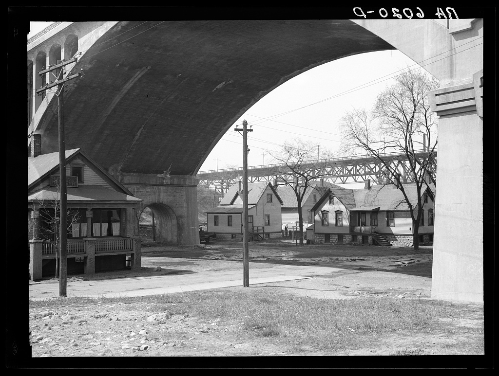 <table class=&quot;lightbox&quot;><tr><td colspan=2 class=&quot;lightbox-title&quot;>Piggsville Homes Under the Wisconsin Avenue Viaduct</td></tr><tr><td colspan=2 class=&quot;lightbox-caption&quot;>Before the Wisconsin Avenue viaduct was torn down, many homes were constructed underneath it, as featured in this photograph from 1936.</td></tr><tr><td colspan=2 class=&quot;lightbox-spacer&quot;></td></tr><tr class=&quot;lightbox-detail&quot;><td class=&quot;cell-title&quot;>Source: </td><td class=&quot;cell-value&quot;>From the Library of Congress Farm Security Administration - Office of War Information Photograph Collection.<br /><a href=&quot;https://www.loc.gov/item/2017761449/&quot; target=&quot;_blank&quot;>Library of Congress</a></td></tr><tr class=&quot;filler-row&quot;><td colspan=2>&nbsp;</td></tr></table>