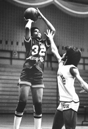 Marquette University's Rita Burch shoots the basketball against at defending UWM player in the late 1970s.