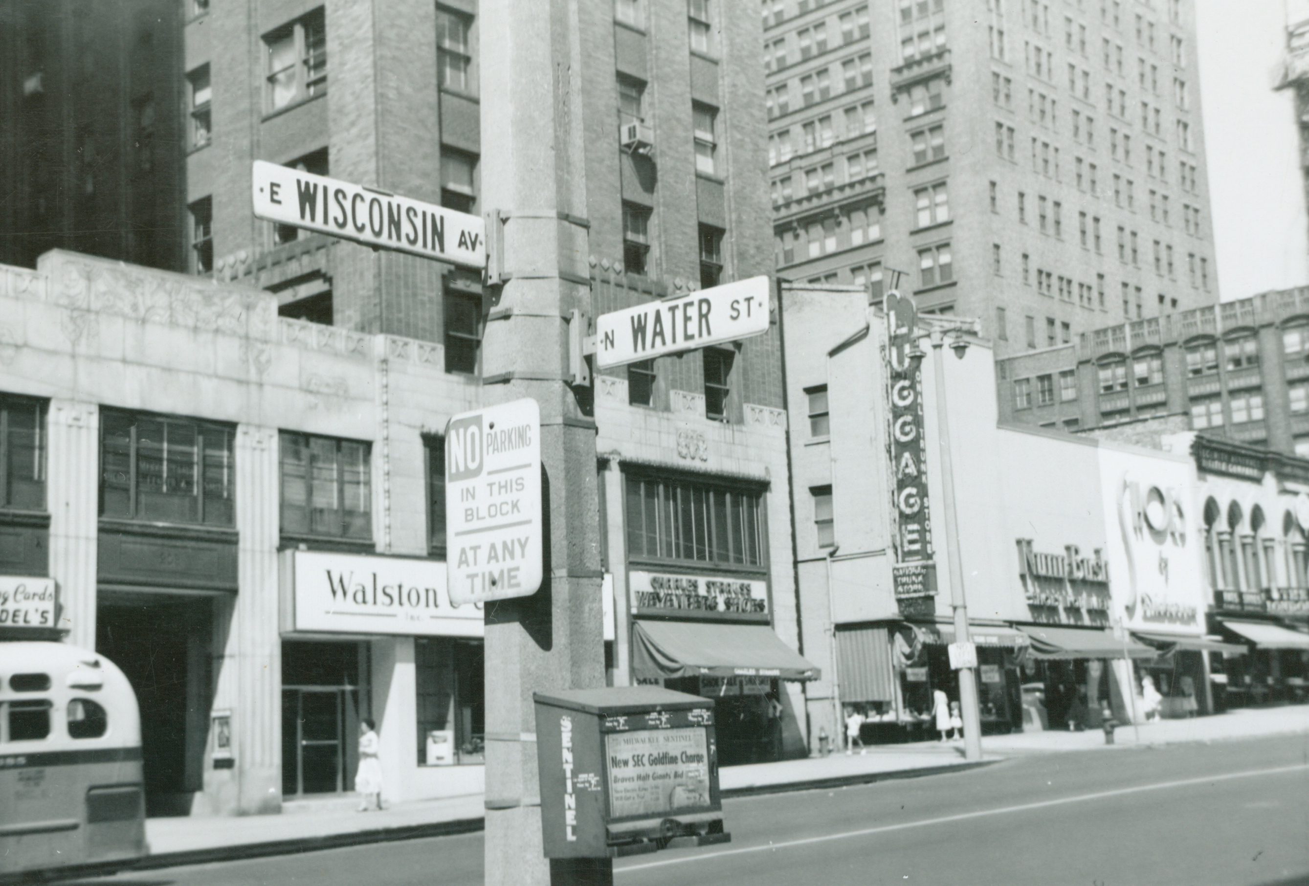 <table class=&quot;lightbox&quot;><tr><td colspan=2 class=&quot;lightbox-title&quot;>The Corner of Water and Wisconsin</td></tr><tr><td colspan=2 class=&quot;lightbox-caption&quot;>Street signs at the intersection Water and Wisconsin are shown in this 1958 photograph.</td></tr><tr><td colspan=2 class=&quot;lightbox-spacer&quot;></td></tr><tr class=&quot;lightbox-detail&quot;><td class=&quot;cell-title&quot;>Source: </td><td class=&quot;cell-value&quot;>From the Historic Photo Collection of the Milwaukee Public Library. Reprinted with permission. <br /><a href=&quot;http://content.mpl.org/cdm/singleitem/collection/HstoricPho/id/570/rec/1&quot; target=&quot;_blank&quot;>Milwaukee Public Library</a></td></tr><tr class=&quot;filler-row&quot;><td colspan=2>&nbsp;</td></tr></table>