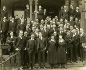 Students of Marquette University's day law school program stand on the porch of the Mackie Home, which housed the law school until 1923, in 1918.