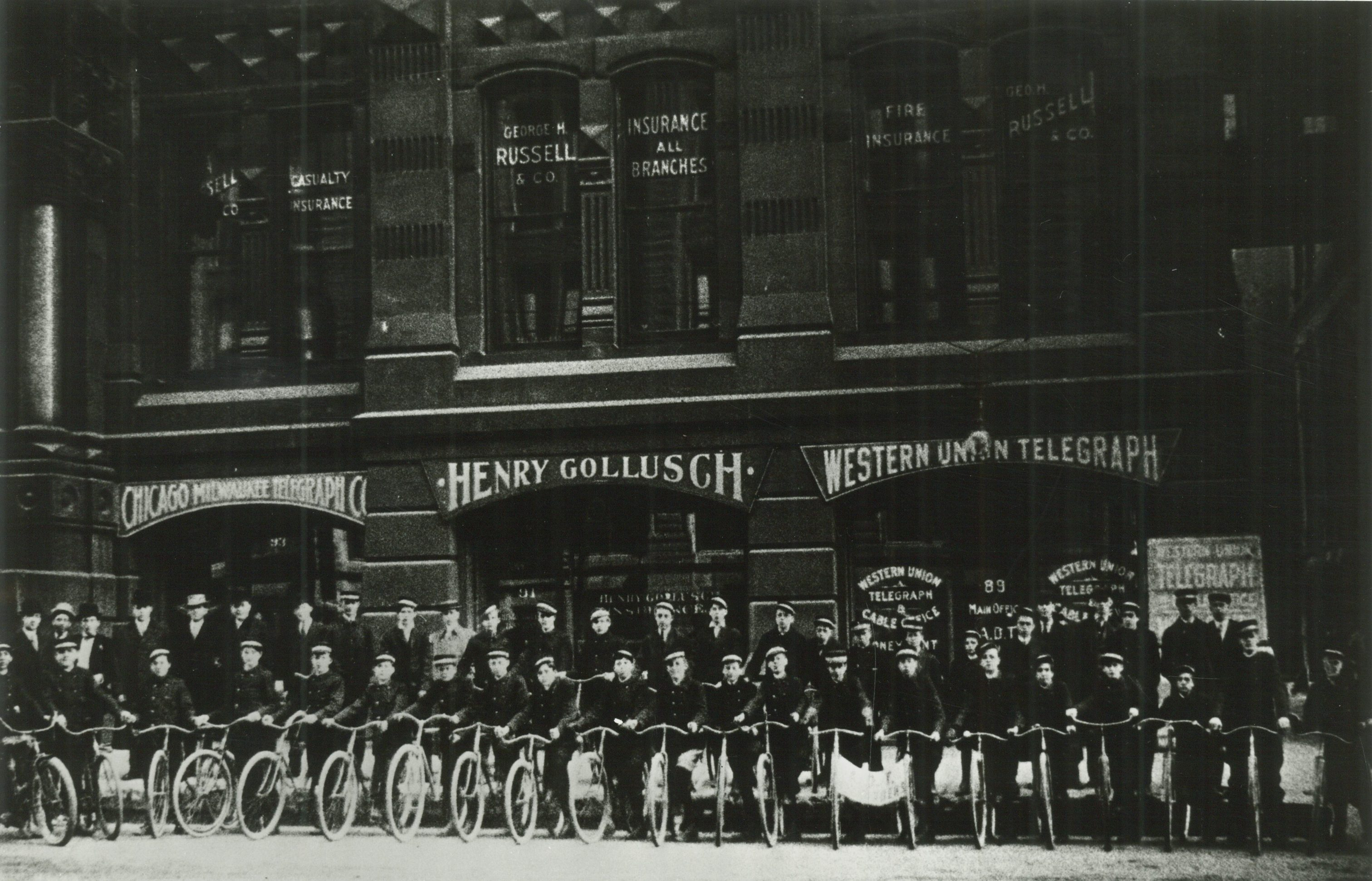 As telecommunications networks developed, they depended less and less on humans to complete the system. This 1909 photograph shows bicycle-riding messengers who delivered telegrams to their final destinations.