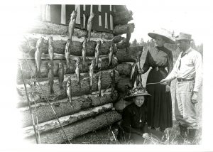 Louise Flancher, Elsa Gruettner, and Edwin Flancher stand near their walleye catch before preparing to ship it from Manitowish to Milwaukee in 1905.