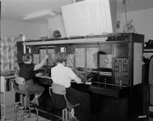 In 1961, human operators still connected telephone callers through a switchboard.