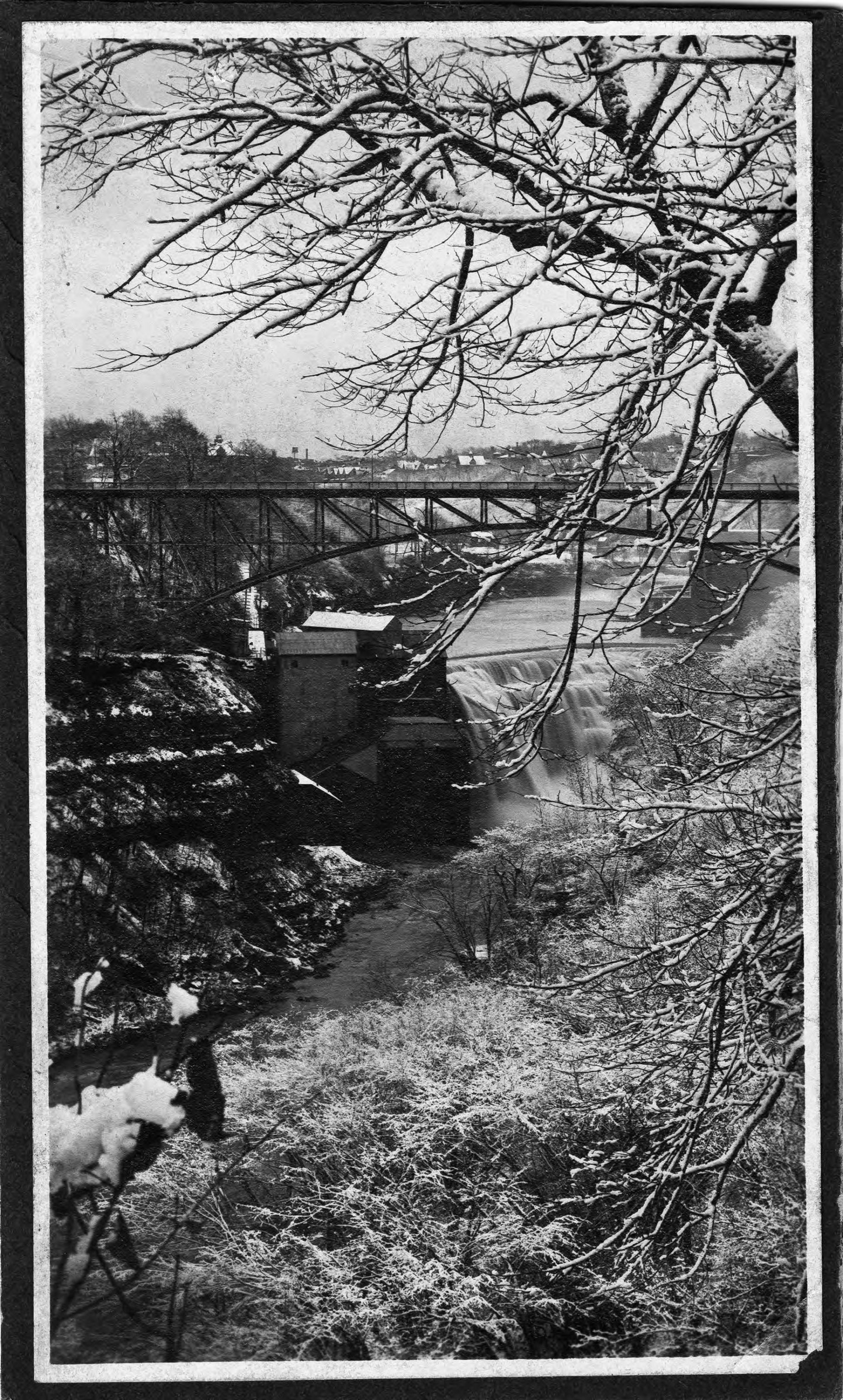 Photographs of watermills are rare because they were largely outmoded by the time photography became common. This undated photograph by Roman Kwasniewski shows a mill, bridge, and waterfall in winter.