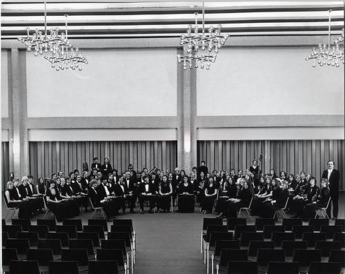 Group portrait of the UWM Symphony Band taken in the 1960s.