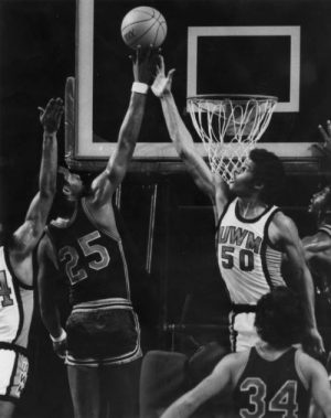 UWM varsity team member Richard Cox battles an opponent for the basketball in 1973.
