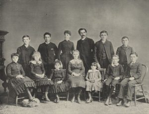 Students from the Milwaukee Day School for the Oral Instruction of the Deaf sit for a formal portrait. This institution opened in 1885 and was Wisconsin's first public day school for the deaf.