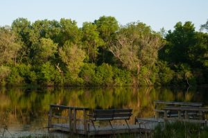 A pier furnished with benches provides a scenic view at the Wehr Nature Center.