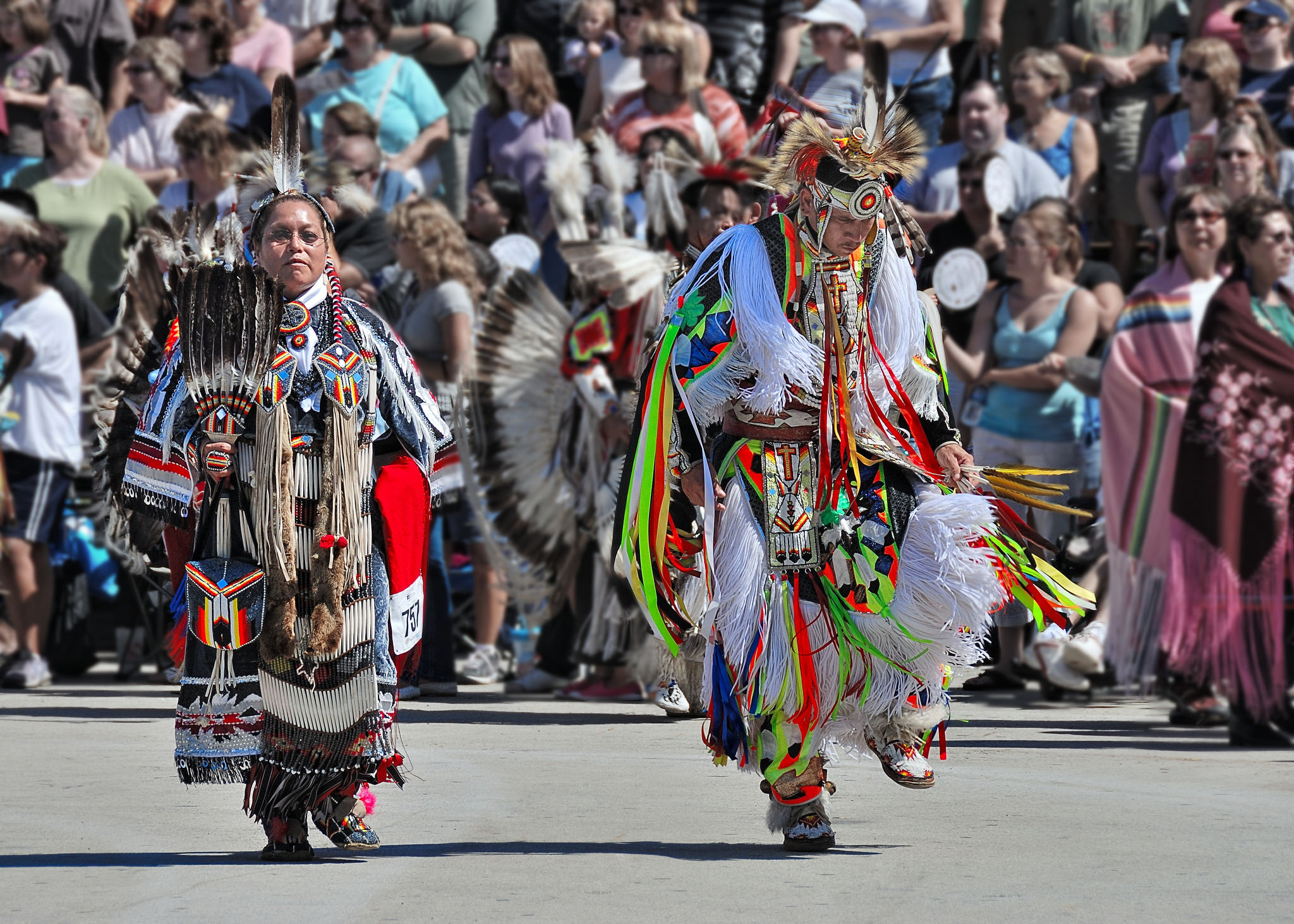Two dancers participate in a powwow at Milwaukee's annual Indian Summer Festival.