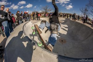 Spectators gather around to watch skateboarders at Tosa Skate Park in Wauwatosa.