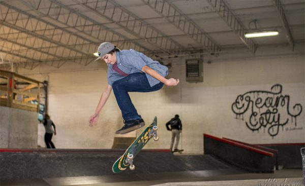 A skateboarder is caught mid-flip at Cream City Skate Park, an indoor facility in Butler.