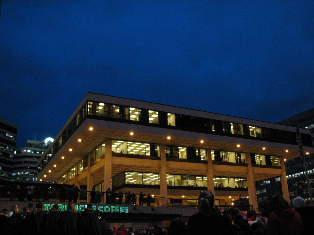 <table class=&quot;lightbox&quot;><tr><td colspan=2 class=&quot;lightbox-title&quot;>MGIC Building</td></tr><tr><td colspan=2 class=&quot;lightbox-caption&quot;>Photograph of the uniquely designed MGIC building taken in 2006. The building forms an upside down pyramid, with each floor constructed to be bigger than the one below it. </td></tr><tr><td colspan=2 class=&quot;lightbox-spacer&quot;></td></tr><tr class=&quot;lightbox-detail&quot;><td class=&quot;cell-title&quot;>Source: </td><td class=&quot;cell-value&quot;>From Flickr. Photograph by Flickr username purpleslog. CC BY 2.0.<br /><a href=&quot;https://www.flickr.com/photos/purpleslog/305984699/&quot; target=&quot;_blank&quot;>Flickr</a></td></tr><tr class=&quot;filler-row&quot;><td colspan=2>&nbsp;</td></tr></table>
