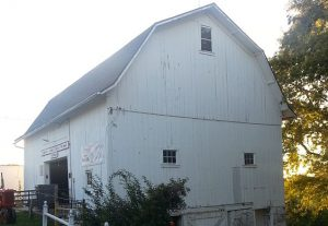 The barn of Weston's Antique Apple Orchard, built in 1906, is part of a larger complex in New Berlin that reflects the area's agricultural history.