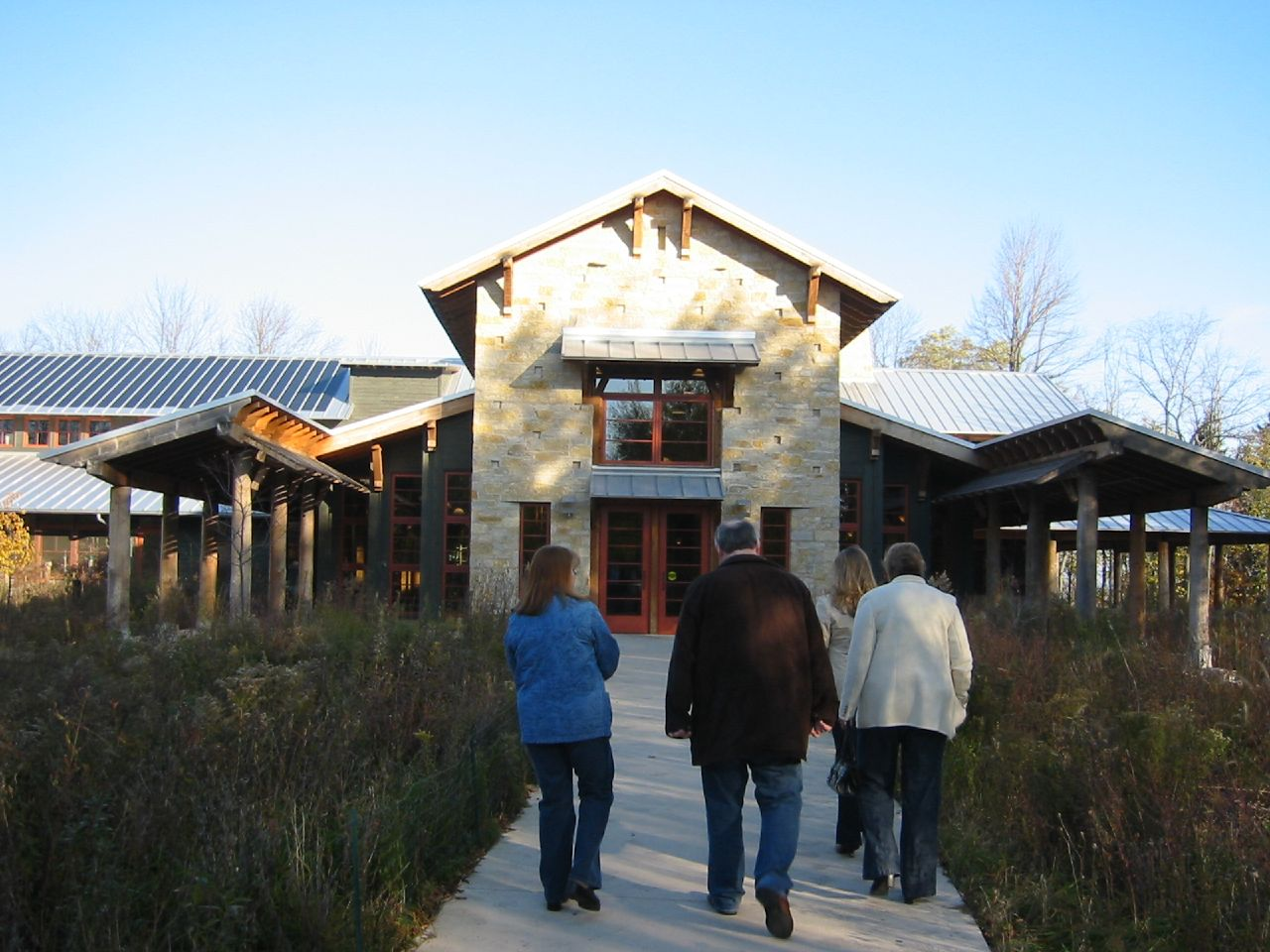 A small group of people walk towards the entrance of the Schlitz Audubon Nature Center in 2005.