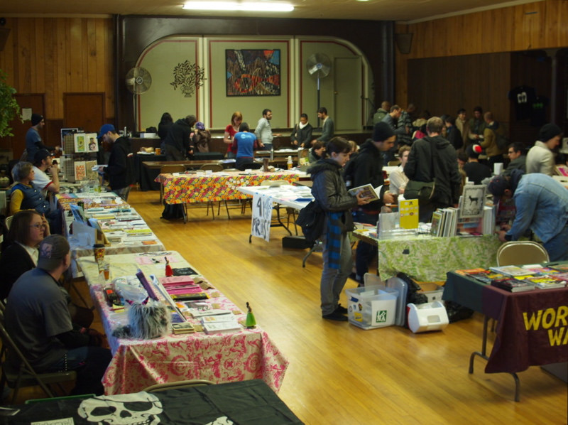 <table class=&quot;lightbox&quot;><tr><td colspan=2 class=&quot;lightbox-title&quot;>Milwaukee Zine Fest</td></tr><tr><td colspan=2 class=&quot;lightbox-caption&quot;>Held annually in Riverwest, the Milwaukee Zine Fest reflects Milwaukee's diverse literary community.</td></tr><tr><td colspan=2 class=&quot;lightbox-spacer&quot;></td></tr><tr class=&quot;lightbox-detail&quot;><td class=&quot;cell-title&quot;>Source: </td><td class=&quot;cell-value&quot;>From Flickr. Photograph by Eric Bartholomew. CC BY-NC-ND 2.0.<br /><a href=&quot;https://www.flickr.com/photos/uber-tuber/8156810741/in/album-72157631931945893/&quot; target=&quot;_blank&quot;>Flickr</a></td></tr><tr class=&quot;filler-row&quot;><td colspan=2>&nbsp;</td></tr></table>
