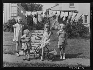 Four girls from Greendale, a community initially developed by the federal government in 1936, smile for the camera in 1939.
