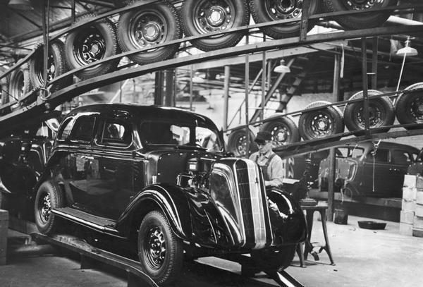 An employee works on a nearly-finished automobile at the Nash Motors plant in Kenosha in 1935.
