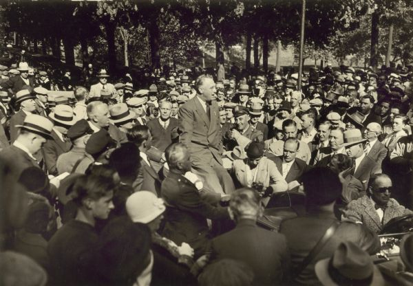 <table class=&quot;lightbox&quot;><tr><td colspan=2 class=&quot;lightbox-title&quot;>President Roosevelt Visits Milwaukee</td></tr><tr><td colspan=2 class=&quot;lightbox-caption&quot;>Photograph of President Franklin D. Roosevelt in the middle of a large crowd in 1932. </td></tr><tr><td colspan=2 class=&quot;lightbox-spacer&quot;></td></tr><tr class=&quot;lightbox-detail&quot;><td class=&quot;cell-title&quot;>Source: </td><td class=&quot;cell-value&quot;>From the Wisconsin Historical Society, WHS-56977. Reprinted with permission. <br /><a href=&quot;https://www.wisconsinhistory.org/Records/Image/IM56977&quot; target=&quot;_blank&quot;>Wisconsin Historical Society</a></td></tr><tr class=&quot;filler-row&quot;><td colspan=2>&nbsp;</td></tr></table>
