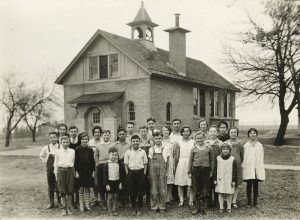 A group of students stand outside their one-room schoolhouse located in Waukesha County in 1933.