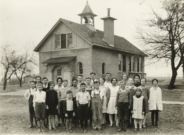 <table class=&quot;lightbox&quot;><tr><td colspan=2 class=&quot;lightbox-title&quot;>Students at Hillcrest School</td></tr><tr><td colspan=2 class=&quot;lightbox-caption&quot;>A group of students stand outside their one-room schoolhouse located in Waukesha County in 1933.</td></tr><tr><td colspan=2 class=&quot;lightbox-spacer&quot;></td></tr><tr class=&quot;lightbox-detail&quot;><td class=&quot;cell-title&quot;>Source: </td><td class=&quot;cell-value&quot;>From the Wisconsin Historical Society, WHS-86209. Reprinted with permission.</td></tr><tr class=&quot;filler-row&quot;><td colspan=2>&nbsp;</td></tr></table>