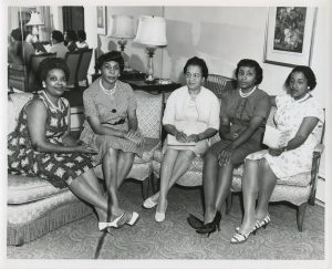 To support the group's scholarship fund, the Milwaukee NAACP hosted a Freedom Fund Dinner. Five of the 1962 committee members seated here are, from left to right, Mrs. Bernice K. Rose; Mrs. Wilhelmina F. Hardy; Mrs. Ardie A. Halyard, chairman; Mrs. Helen M. Reed; and Mrs. Ola Lamkins.