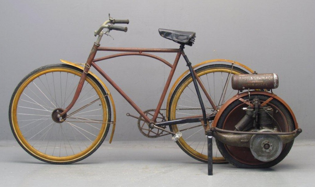 <table class=&quot;lightbox&quot;><tr><td colspan=2 class=&quot;lightbox-title&quot;>Briggs &amp; Stratton Motorwheel</td></tr><tr><td colspan=2 class=&quot;lightbox-caption&quot;>Photograph of a Briggs &amp; Stratton 1920 Motorwheel engine mounted to a bicycle.</td></tr><tr><td colspan=2 class=&quot;lightbox-spacer&quot;></td></tr><tr class=&quot;lightbox-detail&quot;><td class=&quot;cell-title&quot;>Source: </td><td class=&quot;cell-value&quot;>From the Wikimedia Commons. Photograph courtesy of Yesterday's Antique Motorcycles. CC BY-SA 2.5.<br /><a href=&quot;https://commons.wikimedia.org/wiki/File:Briggs_%26_Stratton_Motorwheel.jpg&quot; target=&quot;_blank&quot;>Wikimedia Commons</a></td></tr><tr class=&quot;filler-row&quot;><td colspan=2>&nbsp;</td></tr></table>