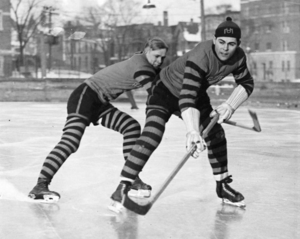 John Cooper and Hank Kearns of Marquette University practice their hockey skills in the late 1920s.