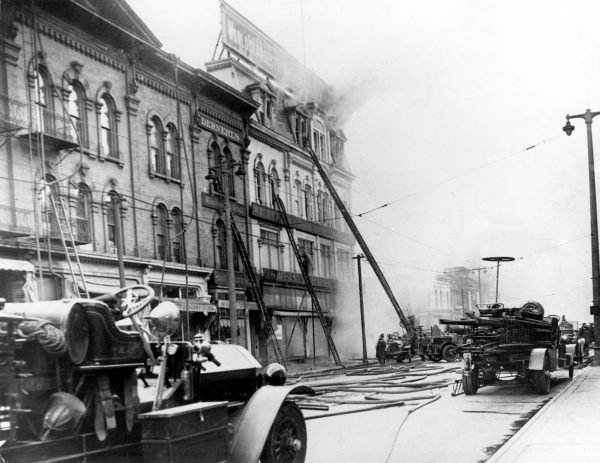 Firefighters battle a blaze at the Hartman Furniture store in June 1926. The fire was so large that 150 firefighters were needed to combat it.