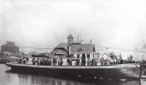 Milwaukee's first fireboat arrived in 1880. In this photograph, it is docked alongside the U.S. Life Saving Station on Jones Island.