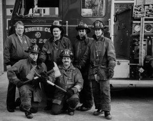 Milwaukee firefighters pose outside their firehouse on 26th Street and Scott Street.