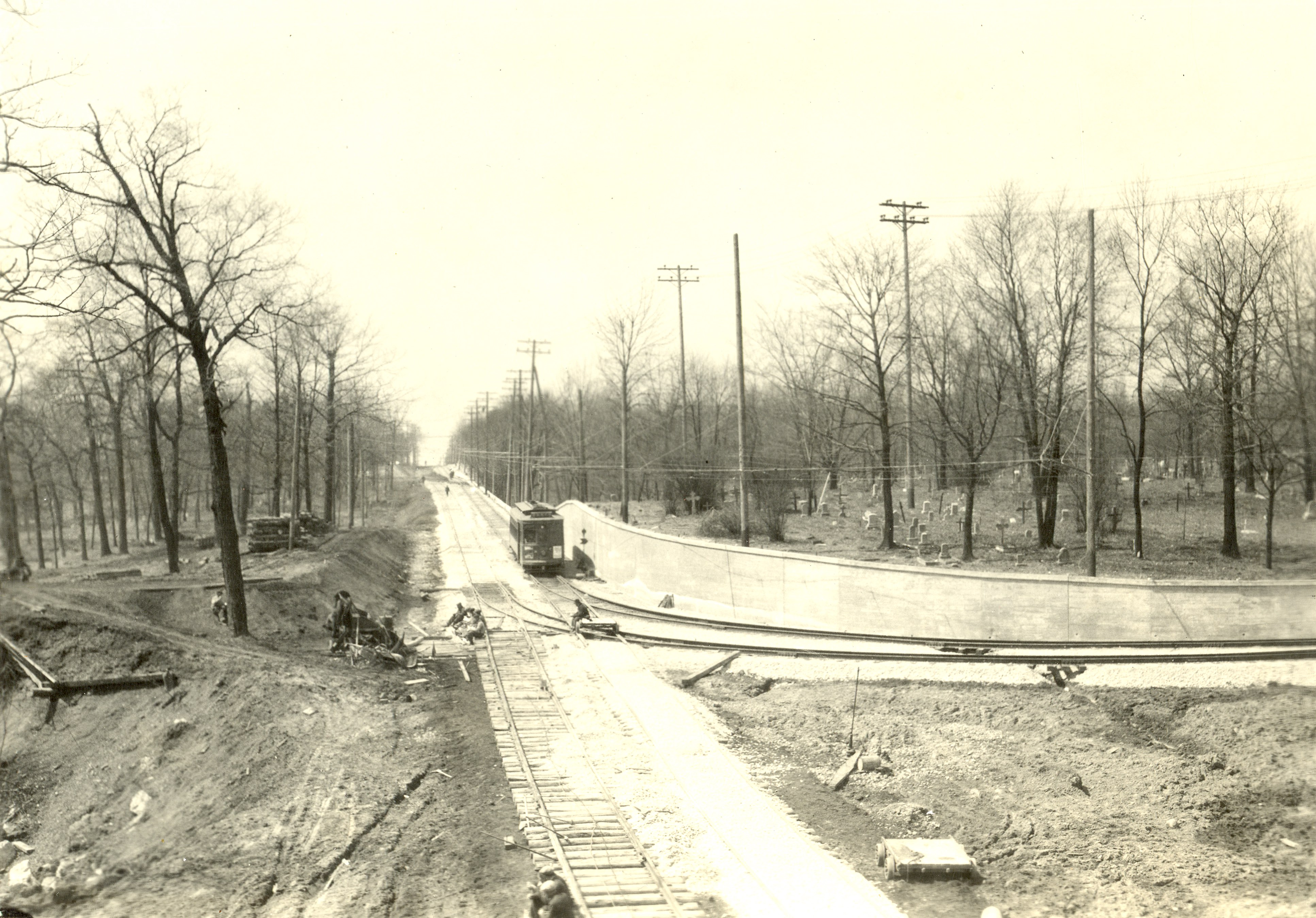 <table class=&quot;lightbox&quot;><tr><td colspan=2 class=&quot;lightbox-title&quot;>Calvary Cemetery in Story Hill</td></tr><tr><td colspan=2 class=&quot;lightbox-caption&quot;>Story Hill's Calvary Cemetery is visible on the right in this photograph  of a streetcar.</td></tr><tr><td colspan=2 class=&quot;lightbox-spacer&quot;></td></tr><tr class=&quot;lightbox-detail&quot;><td class=&quot;cell-title&quot;>Source: </td><td class=&quot;cell-value&quot;>From the Historic Photo Collection of the Milwaukee Public Library. Reprinted with permission.<br /><a href=&quot;http://content.mpl.org/cdm/singleitem/collection/HstoricPho/id/4774/rec/4&quot; target=&quot;_blank&quot;>Milwaukee Public Library</a></td></tr><tr class=&quot;filler-row&quot;><td colspan=2>&nbsp;</td></tr></table>