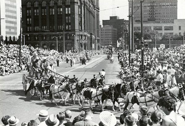 A carriage drawn by a team of ponies turns onto State Street in Milwaukee in 1964.