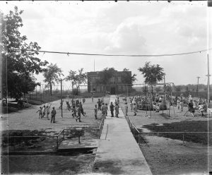 Children run about on the playground at the Milwaukee Home for Dependent Children once located in Wauwatosa.