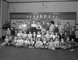 Kindergarten students are gathered together for a group photograph at Cumberland School in 1946. Today, Cumberland Elementary School is part of the Whitefish Bay School District.