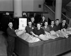 Salesmen at the men's shirt counter inside Gimbels pose for a photograph in 1939.