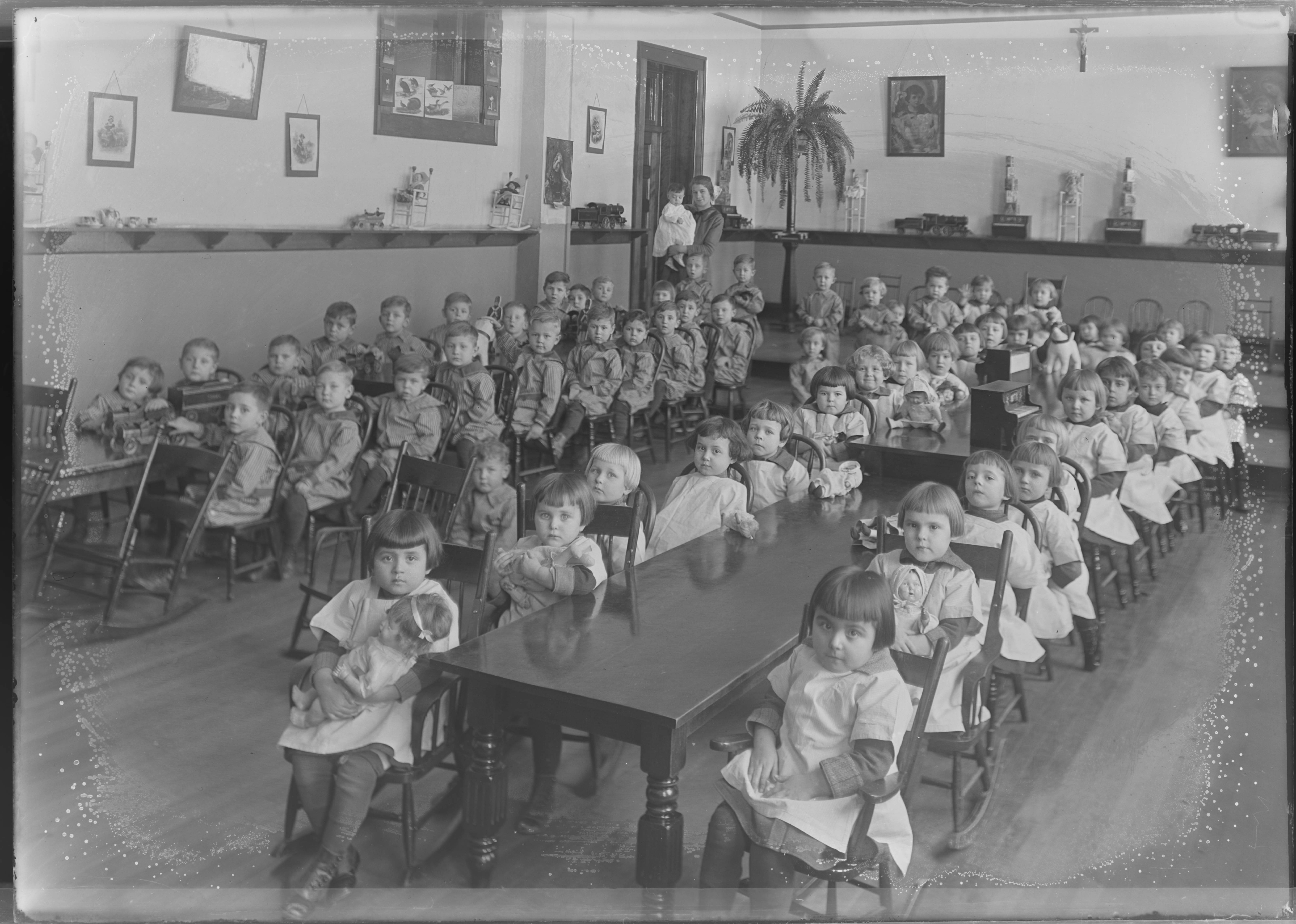 <table class=&quot;lightbox&quot;><tr><td colspan=2 class=&quot;lightbox-title&quot;>Children at St. Joseph's Orphanage</td></tr><tr><td colspan=2 class=&quot;lightbox-caption&quot;>Opened in 1908 to care for children in Milwaukee's growing Polish community, St. Joseph's Orphanage housed children between the ages of three and sixteen. </td></tr><tr><td colspan=2 class=&quot;lightbox-spacer&quot;></td></tr><tr class=&quot;lightbox-detail&quot;><td class=&quot;cell-title&quot;>Source: </td><td class=&quot;cell-value&quot;>From the Roman B. Kwaniewski Photographs Collection, Archives. University of Wisconsin-Milwaukee Libraries.<br /><a href=&quot;https://collections.lib.uwm.edu/digital/collection/mke-polonia/id/35789/rec/3685&quot; target=&quot;_blank&quot;>University of Wisconsin-Milwaukee Libraries</a></td></tr><tr class=&quot;filler-row&quot;><td colspan=2>&nbsp;</td></tr></table>