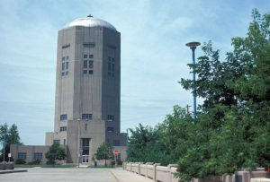 The Town of Lake Water Tower, on South 6th Street in the Tippecanoe neighborhood, was built in 1938 in the Art Deco style. It is shown here in 1975.