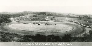 This elevated view shows the Slinger Speedway racetrack in its inaugural year of operation, 1948. The Slinger Super Speedway remains a popular attraction today.