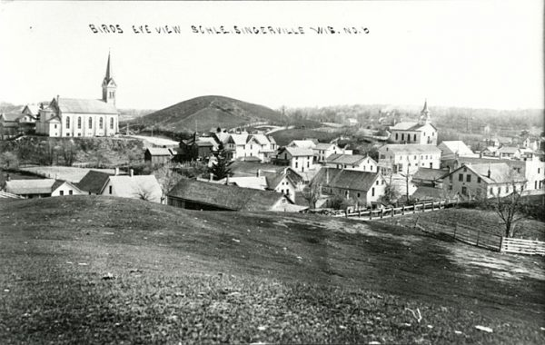 This photo taken from atop a hill looks down towards Slinger in the early 20th century.