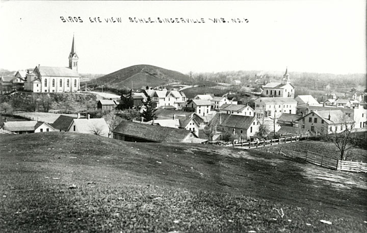 <table class=&quot;lightbox&quot;><tr><td colspan=2 class=&quot;lightbox-title&quot;>A View of Slinger</td></tr><tr><td colspan=2 class=&quot;lightbox-caption&quot;>This photo taken from atop a hill looks down towards Slinger in the early 20th century.</td></tr><tr><td colspan=2 class=&quot;lightbox-spacer&quot;></td></tr><tr class=&quot;lightbox-detail&quot;><td class=&quot;cell-title&quot;>Source: </td><td class=&quot;cell-value&quot;>From the State of Wisconsin Collection of the UW Digital Collections Library. Image ID WI.sling0275.bib. Photograph courtesy of the Slinger Community Library. Fair use for nonprofit educational purposes.</td></tr><tr class=&quot;filler-row&quot;><td colspan=2>&nbsp;</td></tr></table>