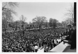 An anti-war crowd gathers at UWM in May 1970 during a month that witnessed the invasion of Cambodia by U.S. military forces and the shooting of student protestors at Kent State University by National Guard troops.