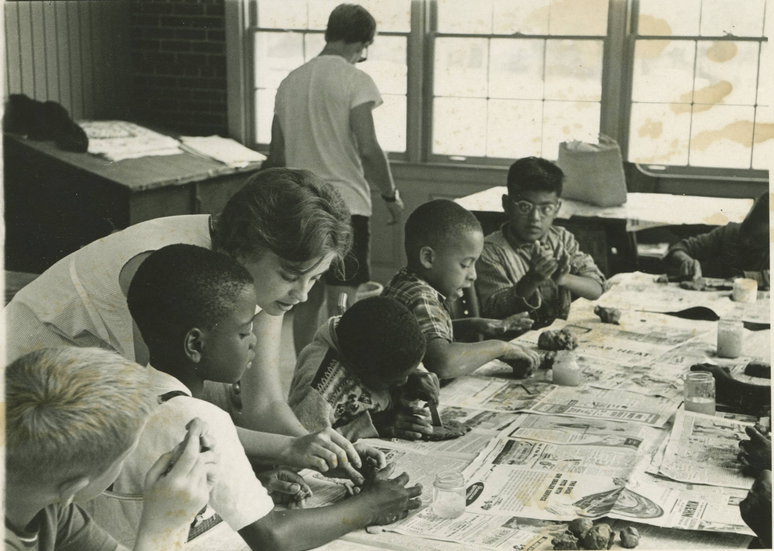<table class=&quot;lightbox&quot;><tr><td colspan=2 class=&quot;lightbox-title&quot;>Children and Their Instructor</td></tr><tr><td colspan=2 class=&quot;lightbox-caption&quot;>A woman works with a small group of children as part of the Milwaukee Handicraft Project, a public works project developed under the WPA during the Great Depression.</td></tr><tr><td colspan=2 class=&quot;lightbox-spacer&quot;></td></tr><tr class=&quot;lightbox-detail&quot;><td class=&quot;cell-title&quot;>Source: </td><td class=&quot;cell-value&quot;>From the Wisconsin Arts Project of the WPA Collection. Archives, University of Wisconsin-Milwaukee Libraries.<br /><a href=&quot;https://collections.lib.uwm.edu/digital/collection/wpa/id/1703/rec/46&quot; target=&quot;_blank&quot;>University of Wisconsin-Milwaukee Libraries</a></td></tr><tr class=&quot;filler-row&quot;><td colspan=2>&nbsp;</td></tr></table>