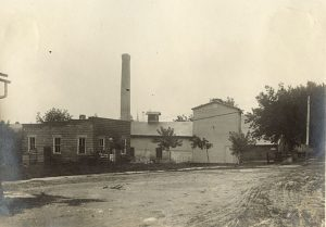 Taken between 1920 and 1930, this photograph shows a creamery and mill owned by the Nestle Company in the Racine County community of Waterford.