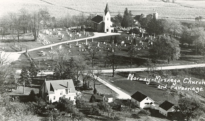 <table class=&quot;lightbox&quot;><tr><td colspan=2 class=&quot;lightbox-title&quot;>Norway-Muskego Church and Parsonage</td></tr><tr><td colspan=2 class=&quot;lightbox-caption&quot;>Birds-eye view of the Norway-Muskego Church and parsonage near Wind Lake in Racine County. The church was dedicated in 1870 and still stands, now known as the Norway Evangelical Lutheran Church.</td></tr><tr><td colspan=2 class=&quot;lightbox-spacer&quot;></td></tr><tr class=&quot;lightbox-detail&quot;><td class=&quot;cell-title&quot;>Source: </td><td class=&quot;cell-value&quot;>From the State of Wisconsin Collection of the UW Digital Collections Library. Image ID WI.wpl00217.bib. Photograph courtesy of Waterford Public Library's Local History Digital Collection. Fair use for nonprofit educational purposes.<br /><a href=&quot;http://digital.library.wisc.edu/1711.dl/WI&quot; target=&quot;_blank&quot;>UW Digital Collections Library</a></td></tr><tr class=&quot;filler-row&quot;><td colspan=2>&nbsp;</td></tr></table>