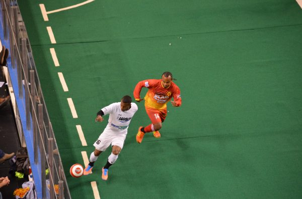 Milwaukee Wave forward Ian Bennett dribbles the ball away from an opponent from the Baltimore Blast in 2013.