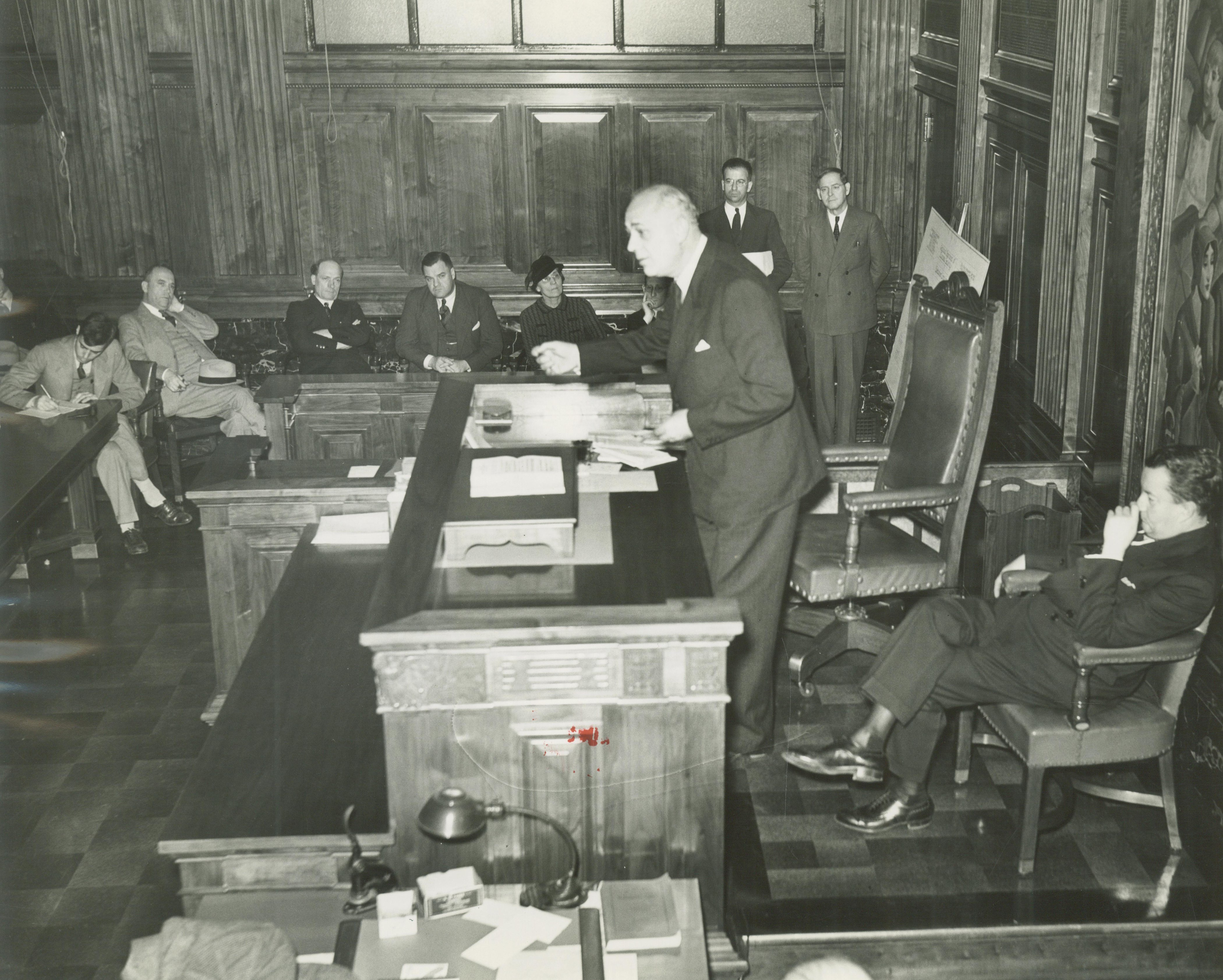 <table class=&quot;lightbox&quot;><tr><td colspan=2 class=&quot;lightbox-title&quot;>Judge Giving a Speech</td></tr><tr><td colspan=2 class=&quot;lightbox-caption&quot;>A Milwaukee judge gives a speech from behind a desk to a room of men and women. </td></tr><tr><td colspan=2 class=&quot;lightbox-spacer&quot;></td></tr><tr class=&quot;lightbox-detail&quot;><td class=&quot;cell-title&quot;>Source: </td><td class=&quot;cell-value&quot;>From the Historic Photo Collection of the Milwaukee Public Library. Reprinted with permission.<br /><a href=&quot;http://content.mpl.org/cdm/singleitem/collection/HstoricPho/id/4365/rec/7&quot; target=&quot;_blank&quot;>Milwaukee Public Library</a></td></tr><tr class=&quot;filler-row&quot;><td colspan=2>&nbsp;</td></tr></table>