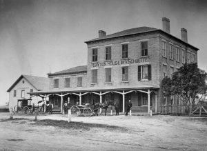 The Layton House, built in 1848, served travelers through what is now Hales Corners in the nineteenth century, shown in this photograph from 1880.