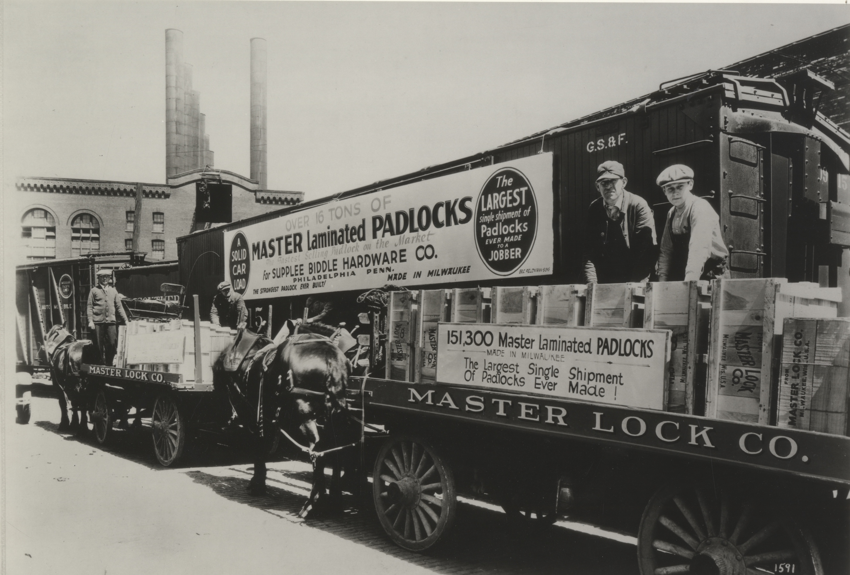 Master Lock padlocks are being loaded onto a train in the twentieth century.