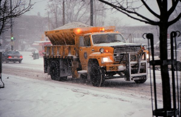 A Milwaukee public works truck lays down salt on Downer Avenue in 1988.